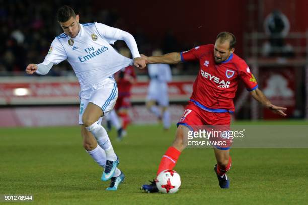 Real Madrid's French defender Theo Hernandez vies with Numancia's defender Unai Medina during the Spanish Copa del Rey round of 16 first leg football...