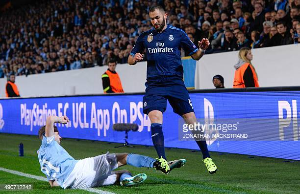 Real Madrid's French forward Karim Benzema and Malmo's Icelandic defender Kari Arnason vie for the ball vie for the ball during the UEFA Champions...