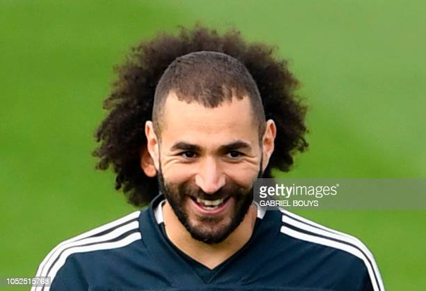 TOPSHOT Real Madrid's French forward Karim Benzema and Real Madrid's Brazilian defender Marcelo attend a training session at the Valdebebas training...