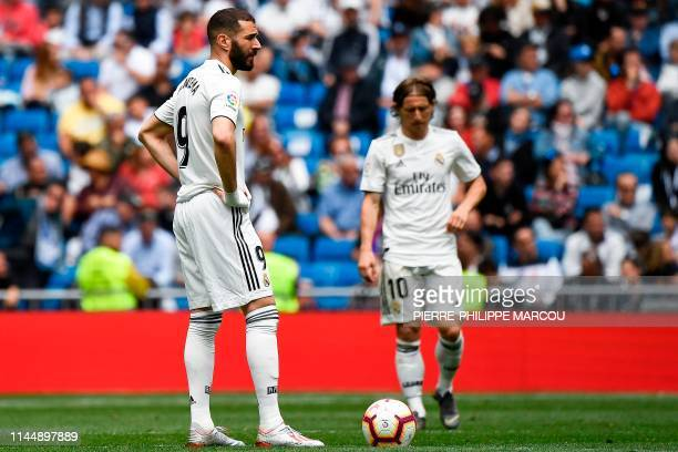 Real Madrid's French forward Karim Benzema and Real Madrid's Croatian midfielder Luka Modric react after Real Betis scored a goal during the Spanish...