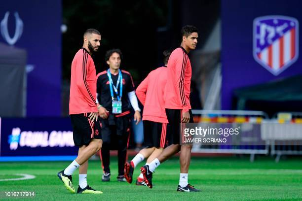 Real Madrid's French forward Karim Benzema and Real Madrid's French defender Raphael Varane take part in a trainig session at Lillekula stadium in...