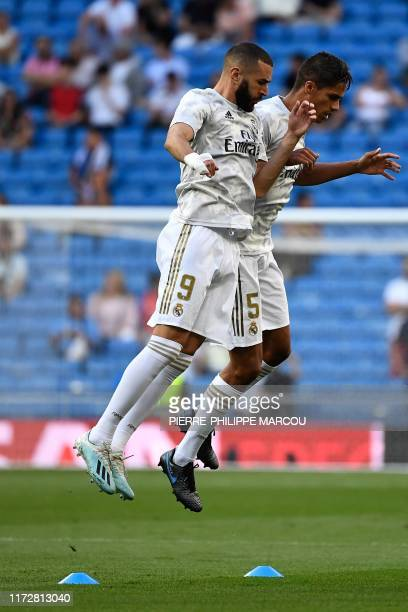 Real Madrid's French forward Karim Benzema and Real Madrid's French defender Raphael Varane warm up prior to the UEFA Champions league Group A...