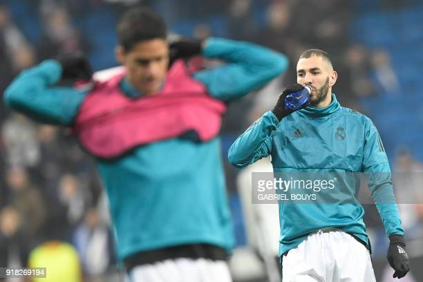 Real Madrid's French forward Karim Benzema and Real Madrid's French defender Raphael Varane warm up before the UEFA Champions League round of sixteen...