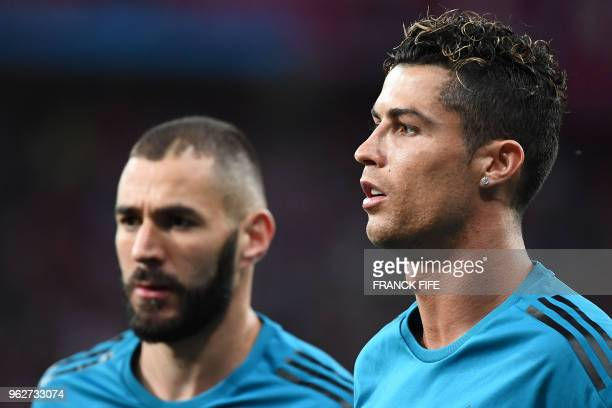 Real Madrid's French forward Karim Benzema and Real Madrid's Portuguese forward Cristiano Ronaldo warm up prior to the during the UEFA Champions...
