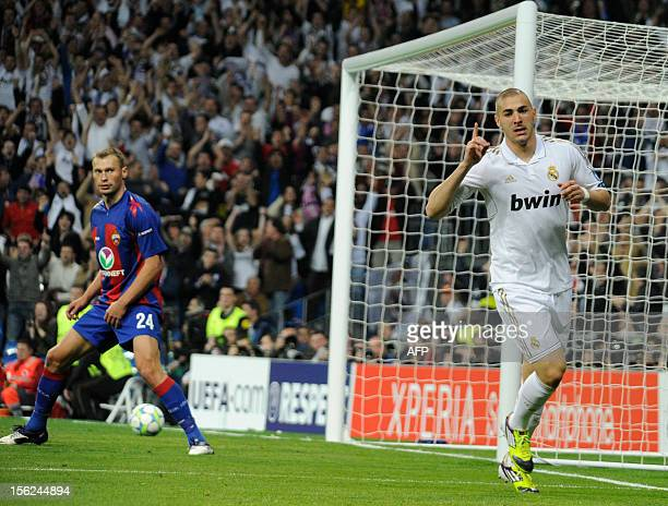 Real Madrid's French forward Karim Benzema celebates after scoring their third goal during the Champions League football match between Real Madrid...