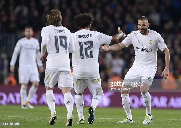 Real Madrid's French forward Karim Benzema celebrate after scoring during the Spanish league 'Clasico' football match FC Barcelona vs Real Madrid CF...