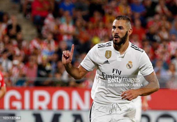 Real Madrid's French forward Karim Benzema celebrates a goal during the Spanish league football match between Girona FC and Real Madrid CF at the...