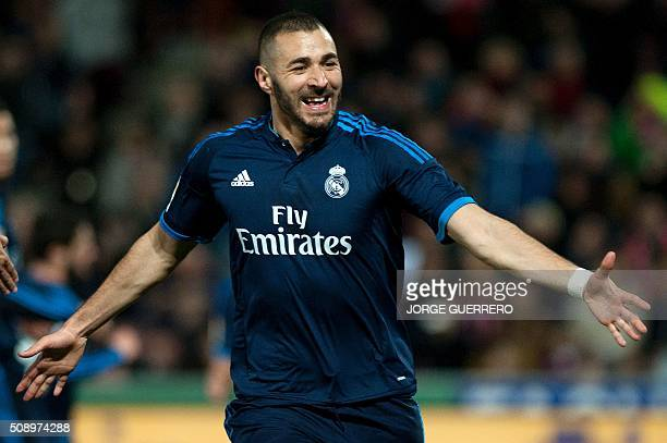 Real Madrid's French forward Karim Benzema celebrates a goal during the Spanish league football match Granada FC vs Real Madrid CF at Nuevo Los...