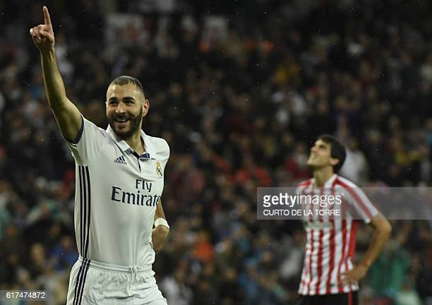 Real Madrid's French forward Karim Benzema celebrates a goal during the Spanish league football match between Real Madrid CF and Athletic Club Bilbao...