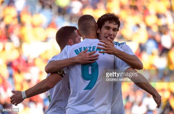 Real Madrid's French forward Karim Benzema celebrates a goal during the Spanish League football match between UD Las Palmas and Real Madrid CF at the...