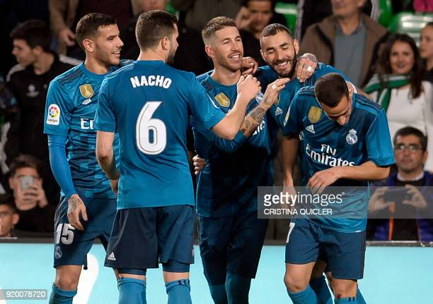 Real Madrid's French forward Karim Benzema celebrates a goal with teammates during the Spanish Liga football match Real Betis vs Real Madrid at the...