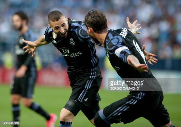 Real Madrid's French forward Karim Benzema celebrates a goal with Real Madrid's defender Sergio Ramos during the Spanish league football match Malaga...