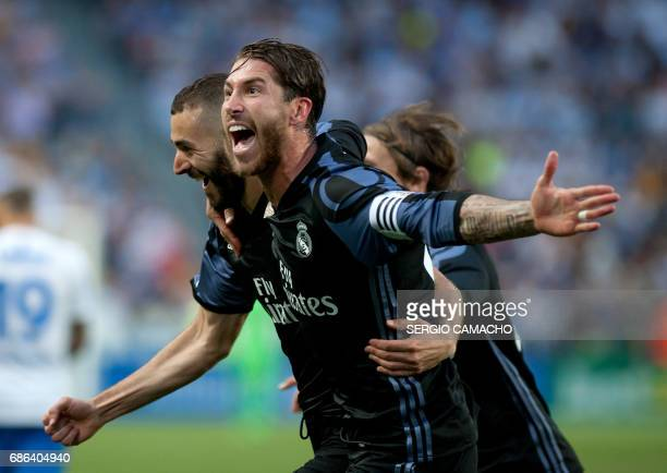 TOPSHOT Real Madrid's French forward Karim Benzema celebrates a goal with Real Madrid's defender Sergio Ramos during the Spanish league football...