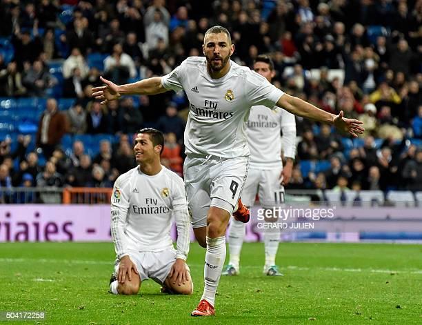 Real Madrid's French forward Karim Benzema celebrates a gola next to Real Madrid's Portuguese forward Cristiano Ronaldo during the Spanish league...