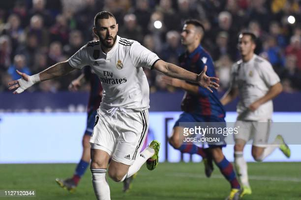 Real Madrid's French forward Karim Benzema celebrates after scoring a goal during the Spanish league football match between Levante UD and Real...