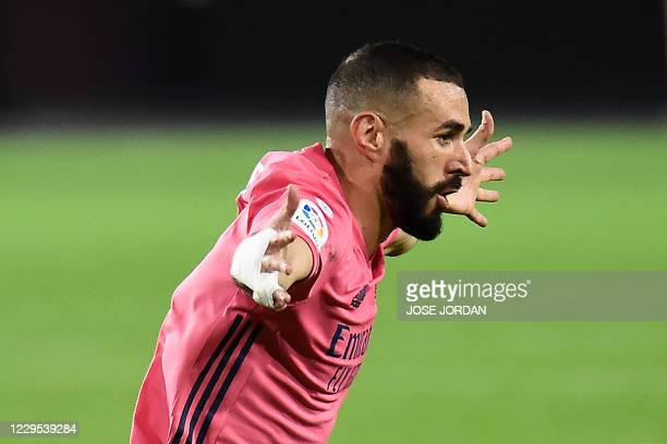 Real Madrid's French forward Karim Benzema celebrates after scoring a goal during the Spanish League football match between Valencia and Real Madrid...