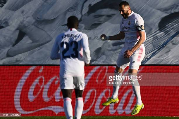 Real Madrid's French forward Karim Benzema celebrates after scoring a goal during the Spanish League football match between Real Madrid and Elche at...
