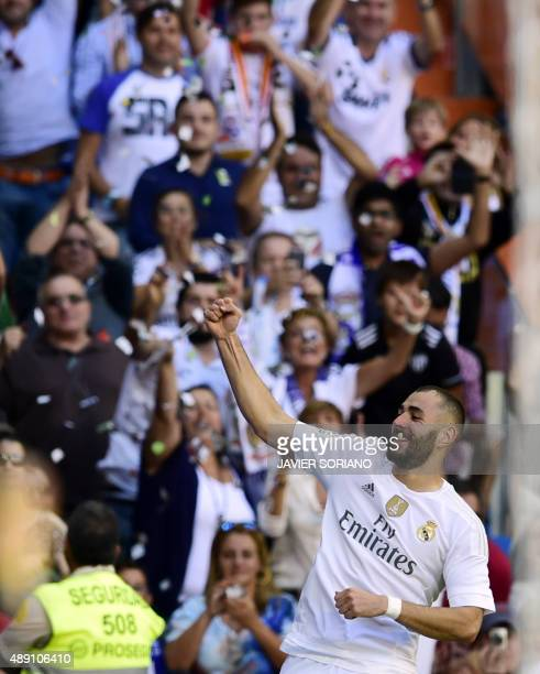 Real Madrid's French forward Karim Benzema celebrates after scoring a goal during the Spanish league football match Real Madrid CF vs Granada FC at...