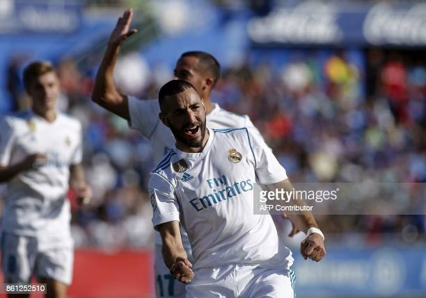 Real Madrid's French forward Karim Benzema celebrates after scoring a goal during the Spanish league football match Getafe CF vs Real Madrid at the...
