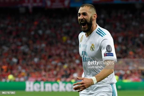 Real Madrid's French forward Karim Benzema celebrates after scoring a goal during the UEFA Champions League final football match between Liverpool...