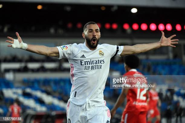 Real Madrid's French forward Karim Benzema celebrates after scoring an eventually disallowed goal during the Spanish League football match between...