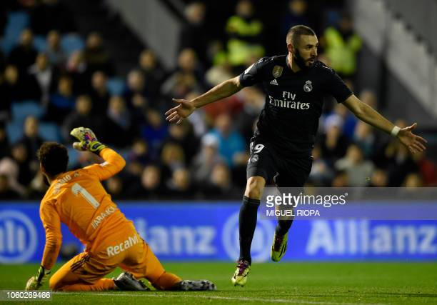 Real Madrid's French forward Karim Benzema celebrates after scoring the opening goal during the Spanish league football match between RC Celta de...