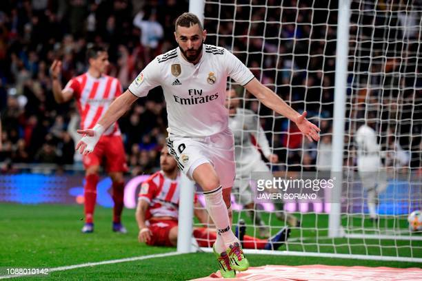 Real Madrid's French forward Karim Benzema celebrates after scoring during the Spanish Copa del Rey quarterfinal first leg football match between...
