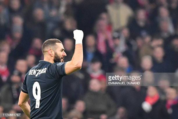 Real Madrid's French forward Karim Benzema celebrates after scoring during the UEFA Champions league round of 16 first leg football match between...