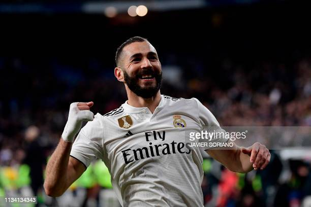 Real Madrid's French forward Karim Benzema celebrates after scoring his team's third goal during the Spanish League football match between Real...