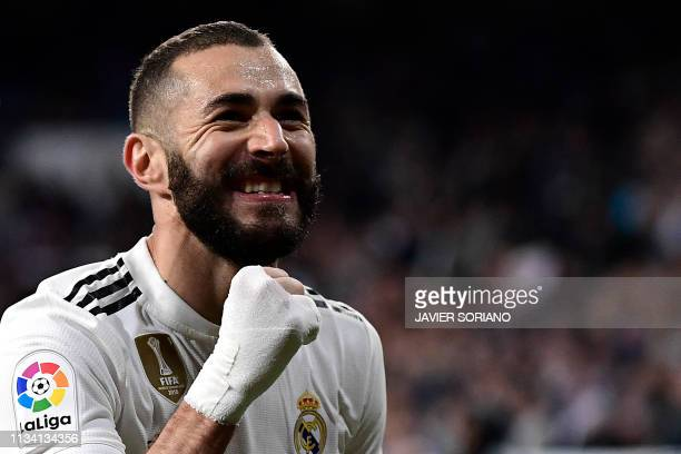 TOPSHOT Real Madrid's French forward Karim Benzema celebrates after scoring his team's third goal during the Spanish League football match between...