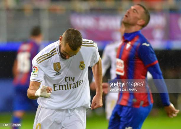 TOPSHOT Real Madrid's French forward Karim Benzema celebrates after scoring during the Spanish league football match between SD Eibar and Real Madrid...