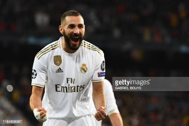 Real Madrid's French forward Karim Benzema celebrates after scoring during the UEFA Champions League group A football match Real Madrid against Paris...
