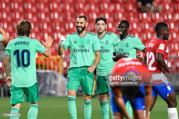 Real Madrid's French forward Karim Benzema celebrates after scoring during the Spanish league football match Granada FC vs Real Madrid CF at Nuevo...