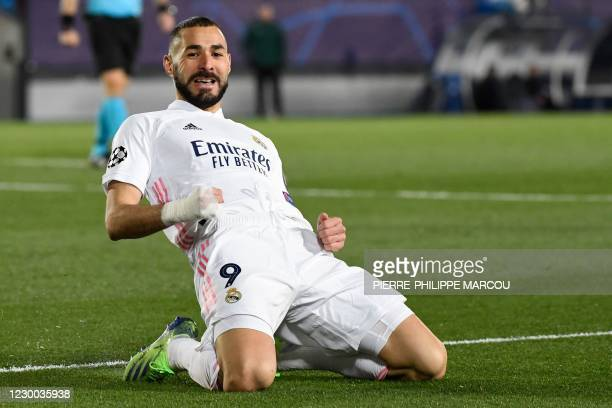Real Madrid's French forward Karim Benzema celebrates after scoring during the UEFA Champions League group B football match between Real Madrid and...
