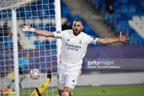 Real Madrid's French forward Karim Benzema celebrates after scoring his second goal during the UEFA Champions League group B football match between...