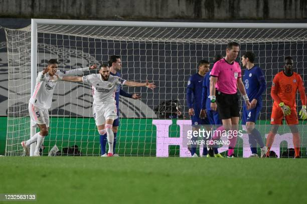 Real Madrid's French forward Karim Benzema celebrates after scoring during the UEFA Champions League semi-final first leg football match between Real...