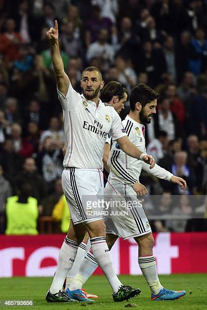 Real Madrid's French forward Karim Benzema celebrates after scoring next to Real Madrid's midfielder Isco during the UEFA Champions League round of...