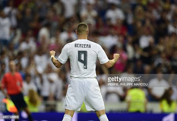 Real Madrid's French forward Karim Benzema celebrates after scoring during the Spanish league football match Real Madrid CF vs Real Betis Balompie at...