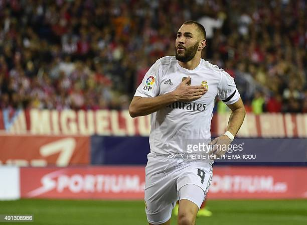Real Madrid's French forward Karim Benzema celebrates after scoring during the Spanish league football match Club Atletico de Madrid vs Real Madrid...