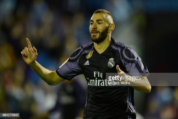 Real Madrid's French forward Karim Benzema celebrates after scoring their third goal during the Spanish league football match RC Celta de Vigo vs...