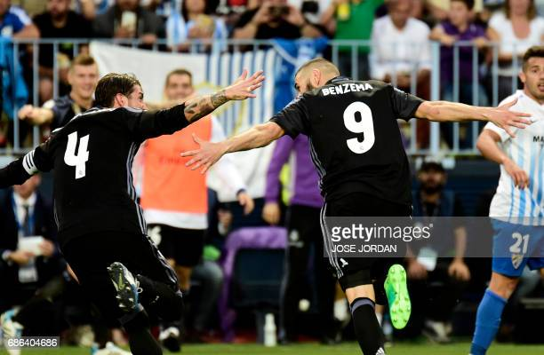 Real Madrid's French forward Karim Benzema celebrates after scoring with Real Madrid's defender Sergio Ramos during the Spanish league football match...