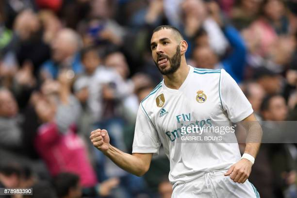 Real Madrid's French forward Karim Benzema celebrates after scoring during the Spanish league football match Real Madrid CF against Malaga CF on 25...
