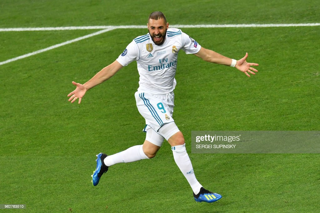 TOPSHOT - Real Madrid's French forward Karim Benzema celebrates after scoring the 0-1 during the UEFA Champions League final football match between Liverpool and Real Madrid at the Olympic Stadium in Kiev, Ukraine on May 26, 2018.