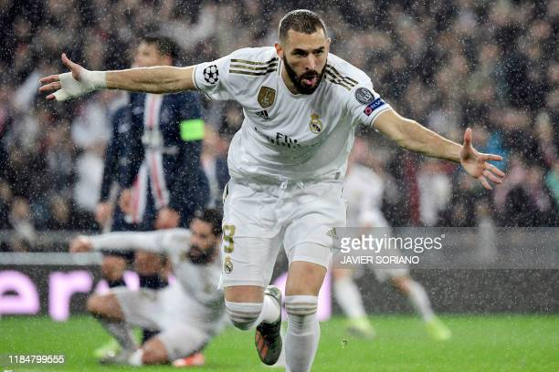 TOPSHOT Real Madrid's French forward Karim Benzema celebrates his goal during the UEFA Champions League group A football match against Paris...