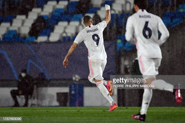 Real Madrid's French forward Karim Benzema celebrates his goal during the UEFA Champions League semi-final first leg football match between Real...
