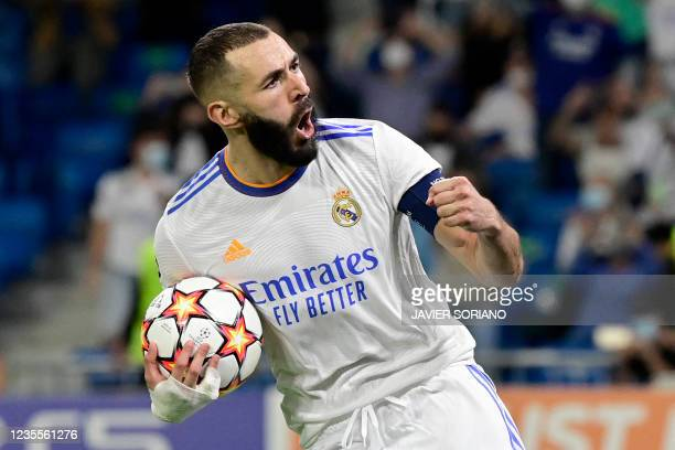 Real Madrid's French forward Karim Benzema celebrates his goal during the UEFA Champions League first round group D footbal match between Real Madrid...