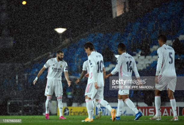 Real Madrid's French forward Karim Benzema celebrates his goal with teammates during the UEFA Champions League semi-final first leg football match...