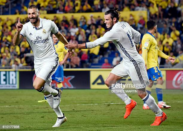 Real Madrid's French forward Karim Benzema celebrates his goal with Real Madrid's Welsh forward Gareth Bale during the Spanish league football match...