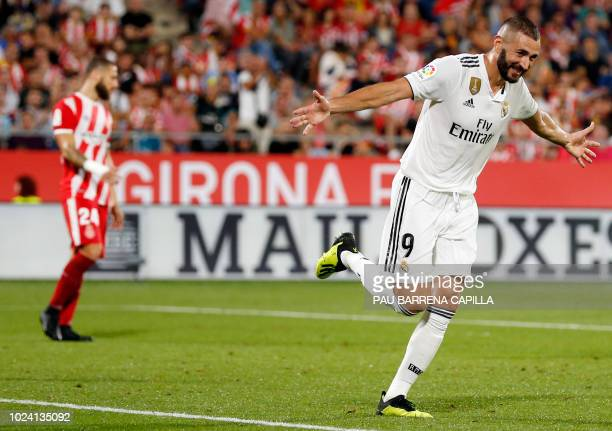 TOPSHOT Real Madrid's French forward Karim Benzema celebrates his second goal during the Spanish league football match between Girona FC and Real...