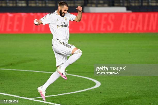 Real Madrid's French forward Karim Benzema celebrates his second goal during the Spanish league football match between Real Madrid CF and Valencia CF...